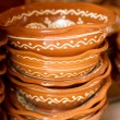 Rustic handmade ceramic clay souvenirs decorated by traditional ornament — Stock Photo
