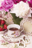 Vintage teacup with spring pi-mesons — Stock Photo