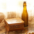 Stock Photo: Wooden box and old empty beer bottle