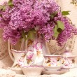 Vintage teacup with spring flowers lilac — Stock Photo