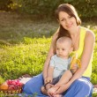 Stock Photo: Young mother with baby