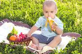 Beautiful little baby boy eats banana — Stock Photo
