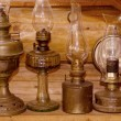 The old kerosene lamps on the wooden background — Stock Photo