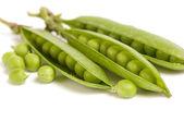 Fresh green peas on white background — Stock Photo