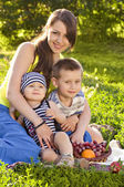 Young mother with little sons — Stock Photo