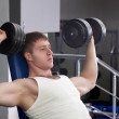 Handsome young muscular sports man in gymnasium — Stock Photo