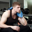Handsome young muscular sports man in gymnasium — Stock Photo #32092897