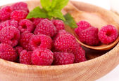 Raspberry in wooden plate — Stock Photo
