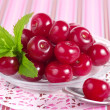 Stock Photo: Sweet cherries on lace serviette