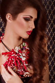 Woman with coral jewelry — Stock Photo