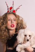 Woman with poodle — Stock Photo