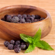 Stock Photo: Blackberry in wooden bowl