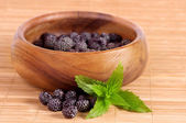Blackberry in wooden bowl — Stock Photo