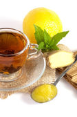 Cup of tea with ginger, lemon, honey and mint — Stock Photo