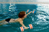 Pregnant woman doing exercises in pool — Photo