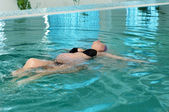 Pregnant woman in a swimming pool — Stock Photo