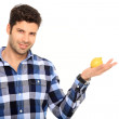 Young man holding a lemon — Stock Photo