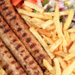 Stock Photo: Kebab with fried potatoes