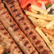 Kebab with fried potatoes — Stock Photo