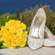 Bridal shoes and flower bouquet — Stock Photo #34833959