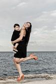 Happy mum at the beach — Stok fotoğraf