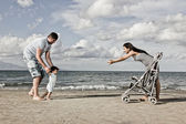 Happy family at the beach — Stock Photo