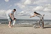 Happy family at the beach — Stock Photo