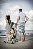 Happy family at the beach — Foto Stock