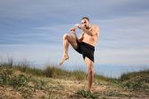 Kick boxer practising outside — Stock Photo
