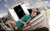 Old boat and a beautiful girl — Stock Photo
