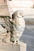 Greek sculpture of an owl in a column — Stock Photo