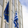 Greek flag in front a building — Stock Photo