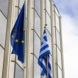 Greek flag in front a building — Stock Photo #41425447