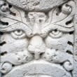 Old marble lion face sculpture — Stock Photo #49533387