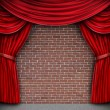Red Curtains On A Brick Wall - Foto Stock