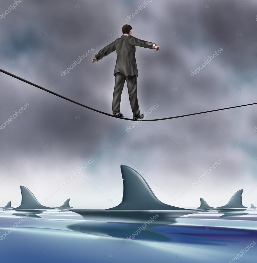 Courage and risk business concept with a business man in a grey suit walking on a tightrope with dangerouse sharks circling underneath as a risk and symbol of determ — Stock Photo #13821644