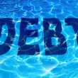 drowning in debt — Stock Photo