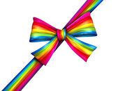 Regenboog diagonale geschenk ribbon bowGökkuşağı çapraz hediye şerit yay — Stockfoto