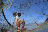 Fisherman catches fish — Stock Photo
