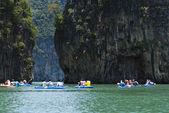 Tourists kayak through limestone cliffs — Stock Photo