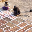Sand paintings for sale outside a temple — Stock Photo #50948053