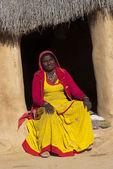 Woman in bright yellow sari — Stock Photo