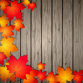 Autumn Leaves over wooden background. — Stock Vector