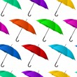 Seamless colorful umbrellas background — Stock Vector #24626137