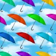 Seamless colorful umbrellas background — Stock Vector