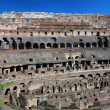 Colosseo or Colosseum, the ancient amphitheatre in Rome - Stock Photo