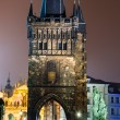 Stare Mesto Tower from the Charles Bridge at night, Prague. - Stockfoto