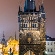 Stare Mesto Tower from the Charles Bridge at night, Prague. - Stock Photo