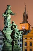 Saint Ivo statue and Smetana clock-tower, Prague. — Stock Photo