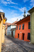 Medieval paved street in Sighisoara, Transylvania. — Stock Photo